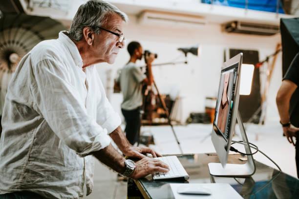 Art director checking photos on a monitor stock photo