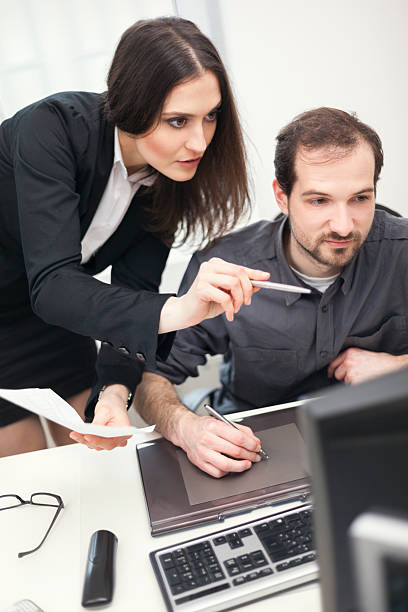 Art director working with graphic designer stock photo