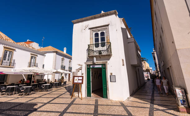 Art exhibit in whitewashed building n Tavira, Portugal stock photo