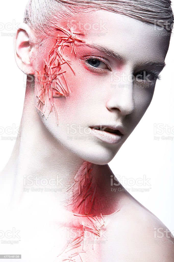 Art fashion girl with white skin and red paint on stock photo