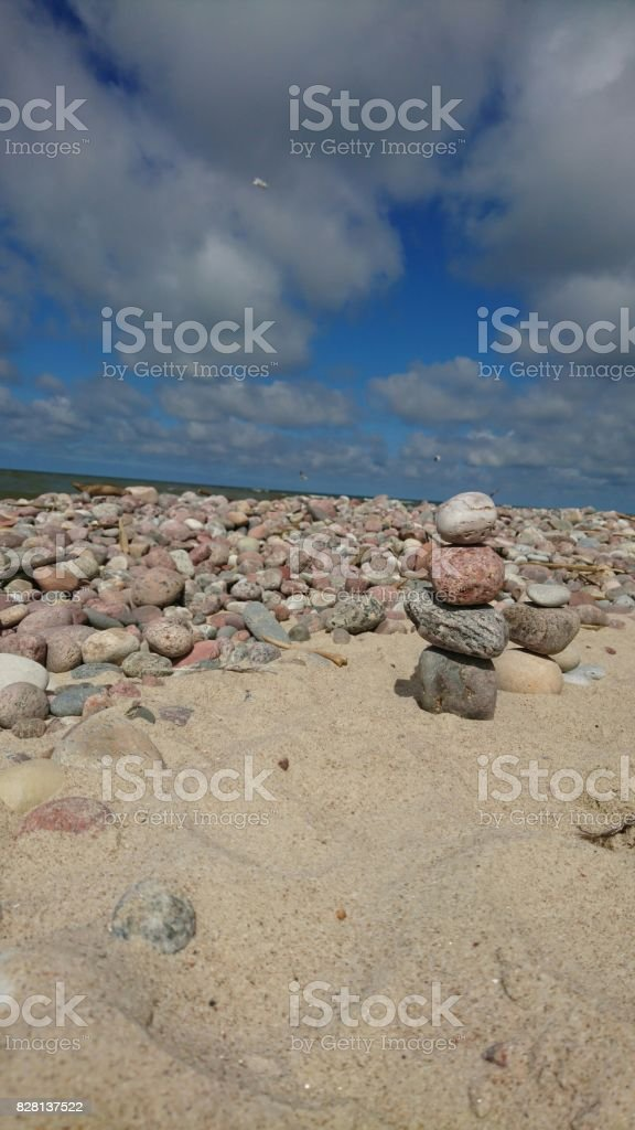 Art from stones in the beach stock photo