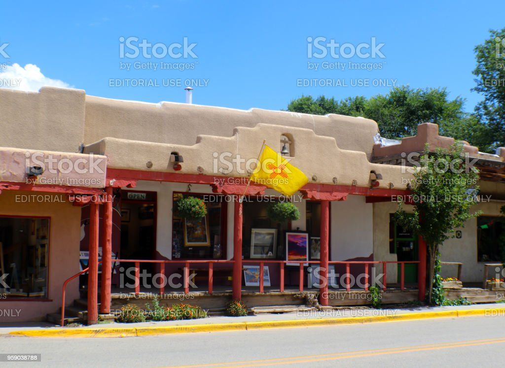 Art Gallery in Taos New Mexico with art displayed on the sidewalk stock photo