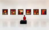 Exhibition centre, a visitor visits an art exhibition and watches artist's collection on the wall,