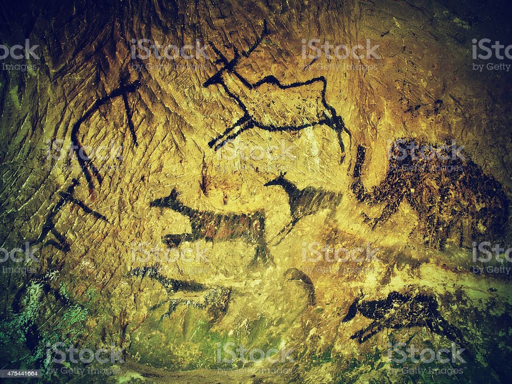 Art in sandstone cave. Black carbon paint of human hunting stock photo