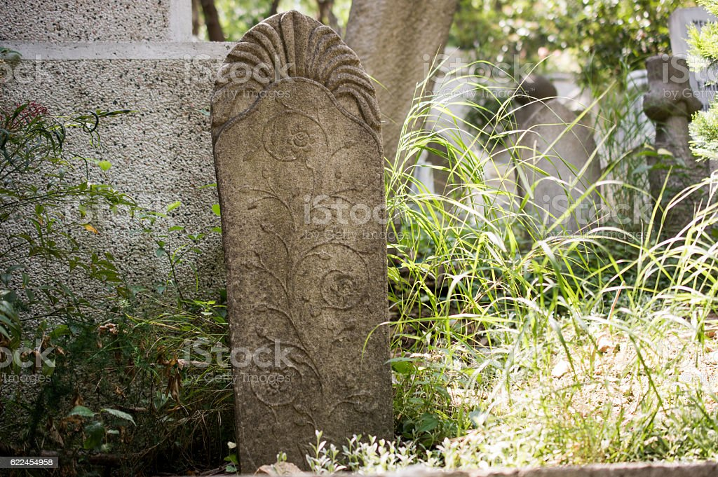 Art in stone of Ottoman tomb in cemetery stock photo