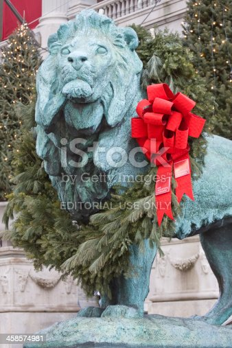 Chicago, IL, USA - January 3, 2009: One of two bronze lions at the Art Institute of Chicago.  Lions are adorned with wreaths during the Christmas season.