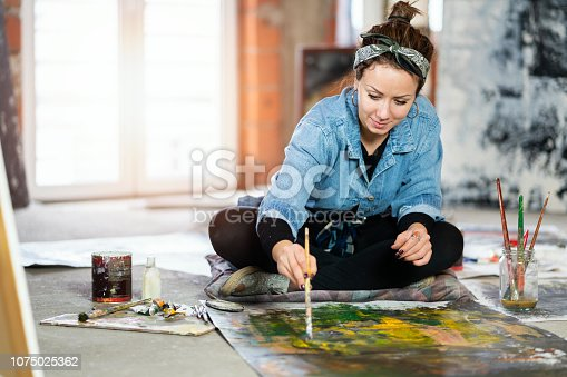 Young woman as artist at her studio