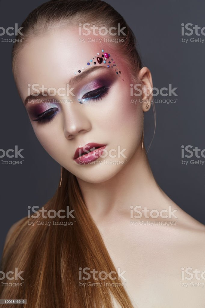 Art Makeup Over The Eyebrows Of Women Many Rhinestones Of Different