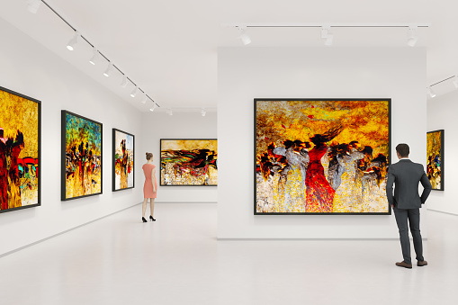 Young couple visits art exhibition and looking at the fine art paintings in a art gallery.