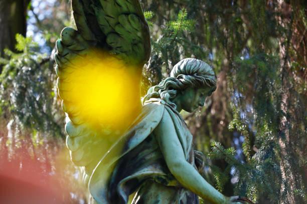 Art nouveau angel statue at Melaten Graveyard, Cologne stock photo