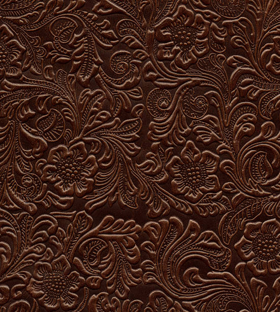 Art Nouveau floral pattern on real leather stock photo