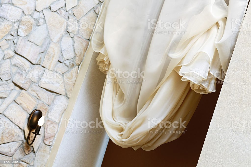 Art nouveau style curtain in window frame, interior detail royalty-free stock photo