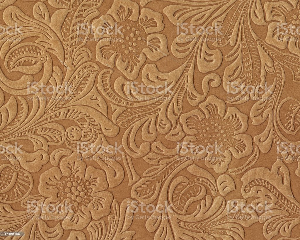 Art Nouveau style floral pattern on leather stock photo