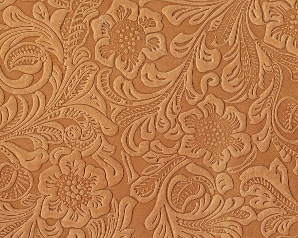 art nouveau style floral pattern on leather - art nouveau stock photos and pictures