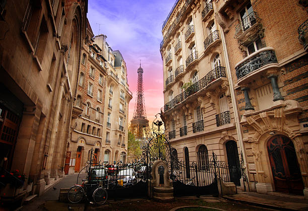 art nouveax buildings and eiffel tower in paris - paris france stock photos and pictures