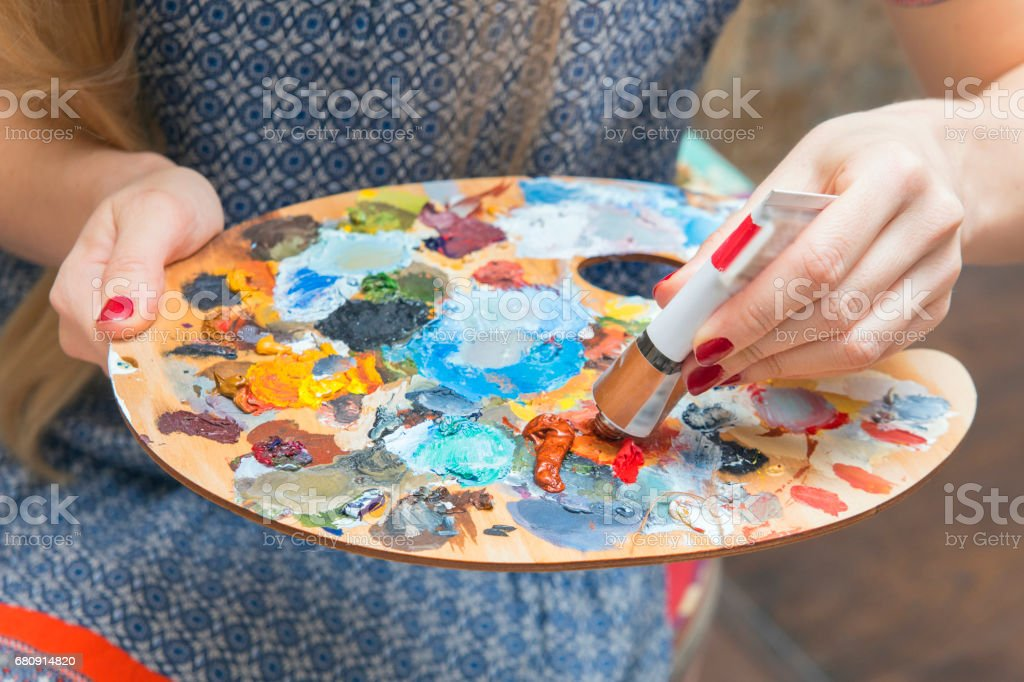 Art of the artist, holding a palette and drawing close up royalty-free stock photo