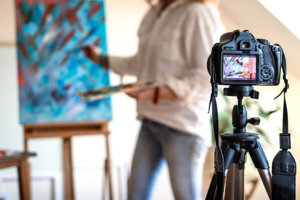 Art painter live streaming from her studio stock photo