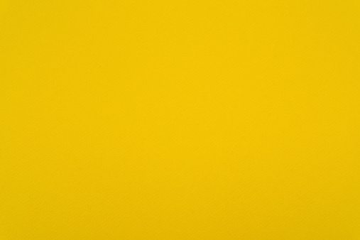 Close up on yellow paper, high resolution image