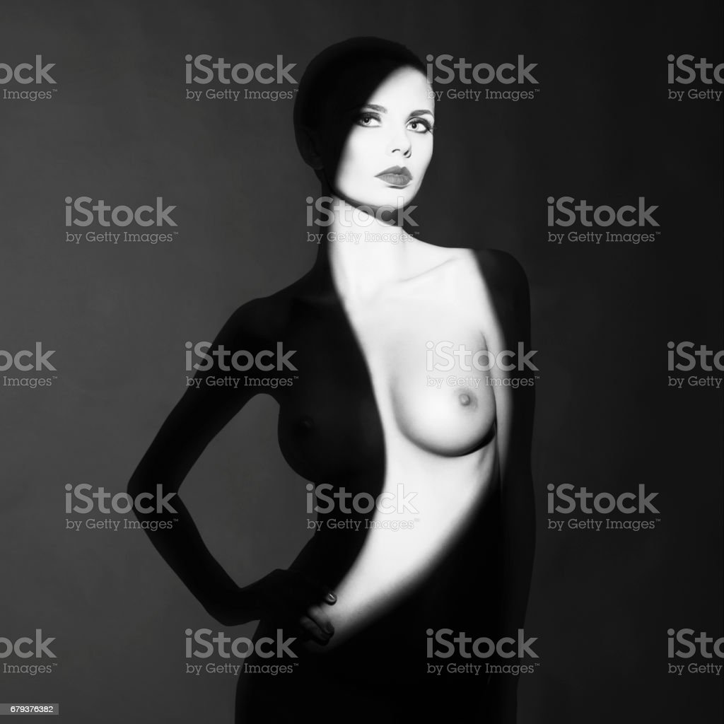Art photo of beautiful nude lady with shadows on her body royalty-free stock photo