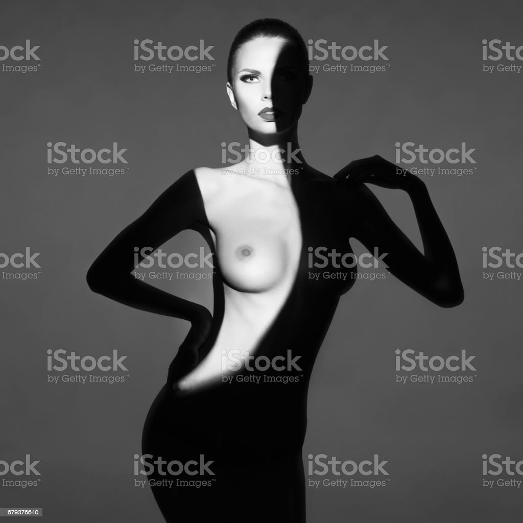 Art photo of beautiful nude lady with shadows on her body stock photo