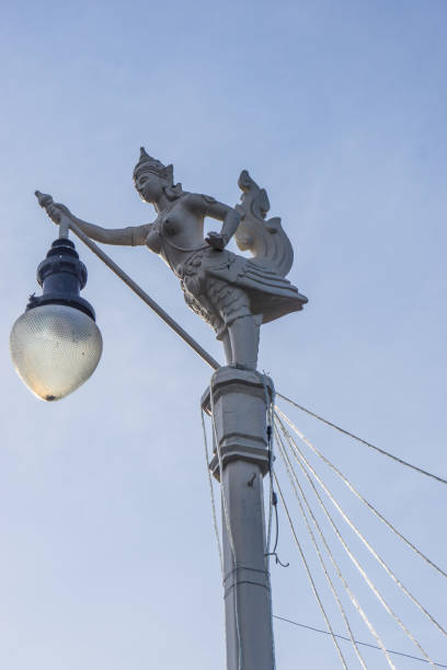THAI Art Statuary female bird with a human head Street Light in Thailand South East Asia Travel Concept. stock photo