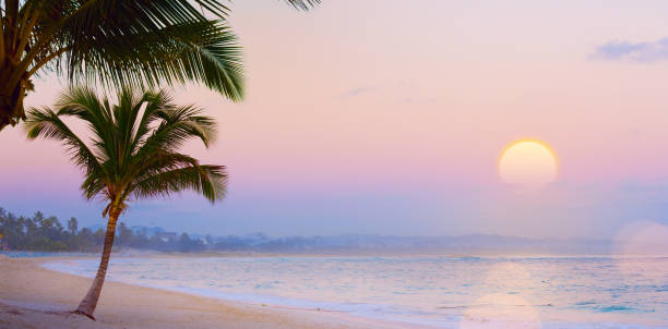 Art Summer Drims; Beautiful sunset over the tropical beach; summer dream vacation stock photo