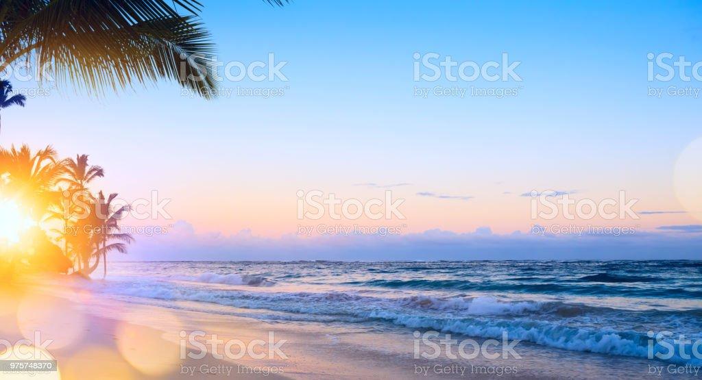 Art summer vacation drims; Beautiful sunrise over the tropical beach stock photo