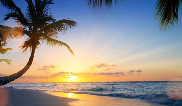Art Summer vacation drims; Beautiful sunset over the tropical beach stock photo