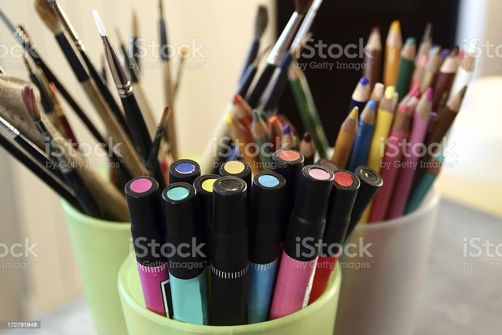 Art supplies filling green cups stock photo