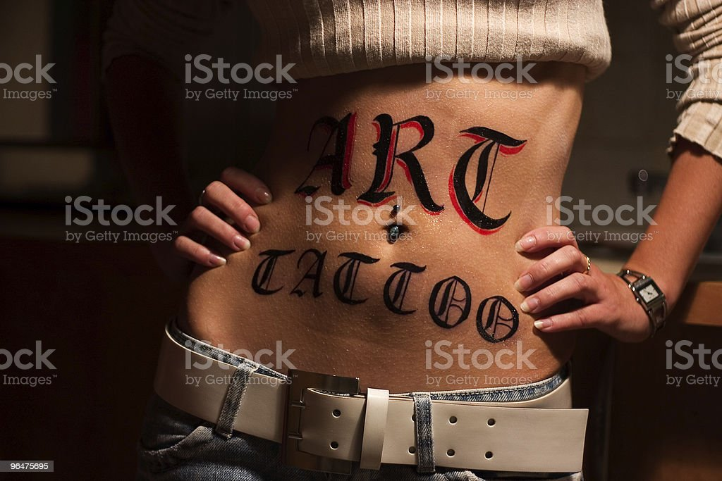 Art tattoo logo on young woman body royalty-free stock photo