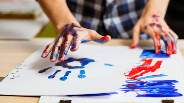 art therapy school paint hand print paper Art therapy class school. Colorful man hand print on white paper. Artist hands smeared with paint. Hobby education. alternative therapy stock pictures, royalty-free photos & images