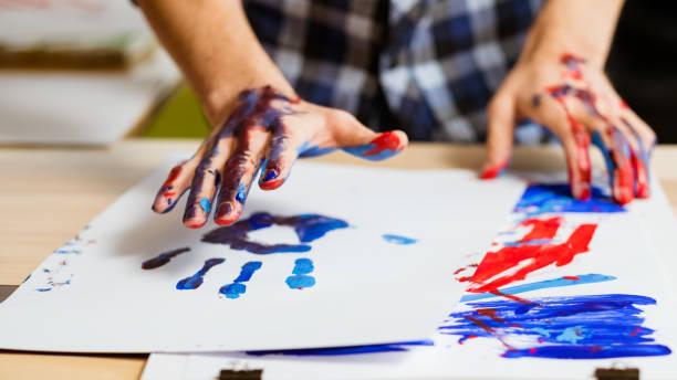 arte de la escuela de terapia de pintura de impresión manual - foto de stock