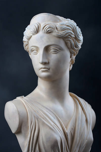 Artemis - Stone bust A copy of a stone bust of the Greek Goddess Artemis, daughter of Zeus, twin sister of Apollo.  This photograph provides a 2/3 view of the face and has dramatic low key lighting. artemis stock pictures, royalty-free photos & images