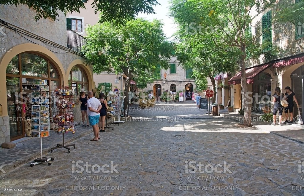 Artesan shop and tourists stock photo