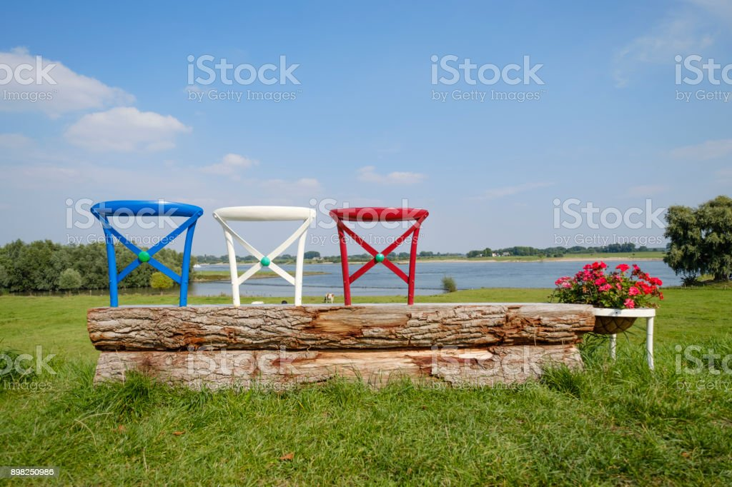 Artful garden bench with different colors of backrest stock photo