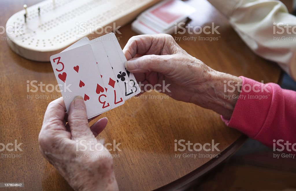 Arthritic Hands Playing Cards, royalty-free stock photo