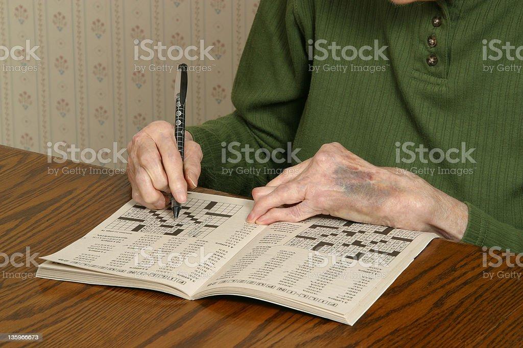 Arthritic Hands with Crossword Puzzle Arthritis Rheumatism royalty-free stock photo