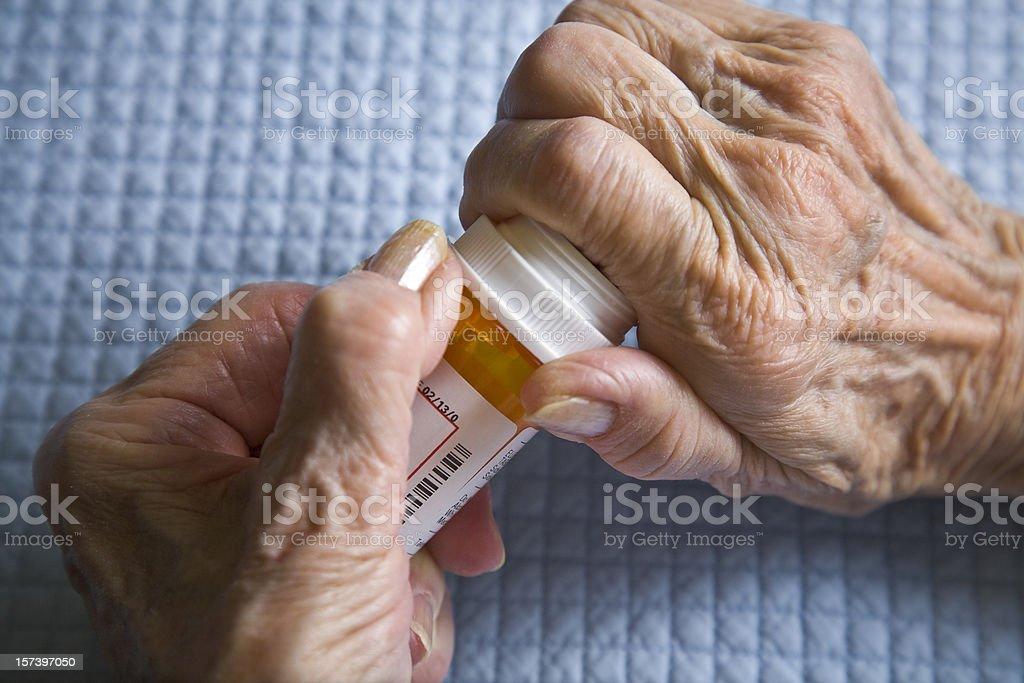 arthritis hands trying to open prescription medicine pill bottle royalty-free stock photo