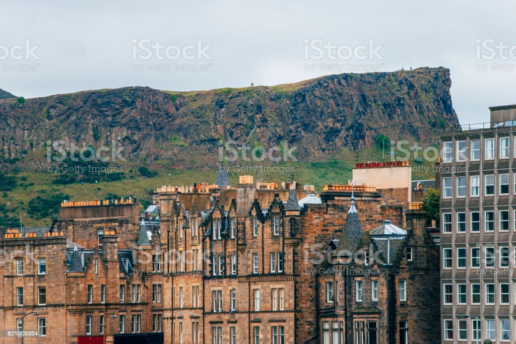 Arthur's Seat and Edinburgh buildings. stock photo