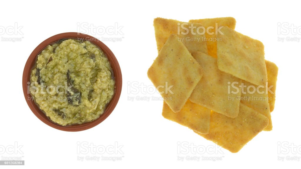 Artichoke dip in small bowl with crackers stock photo