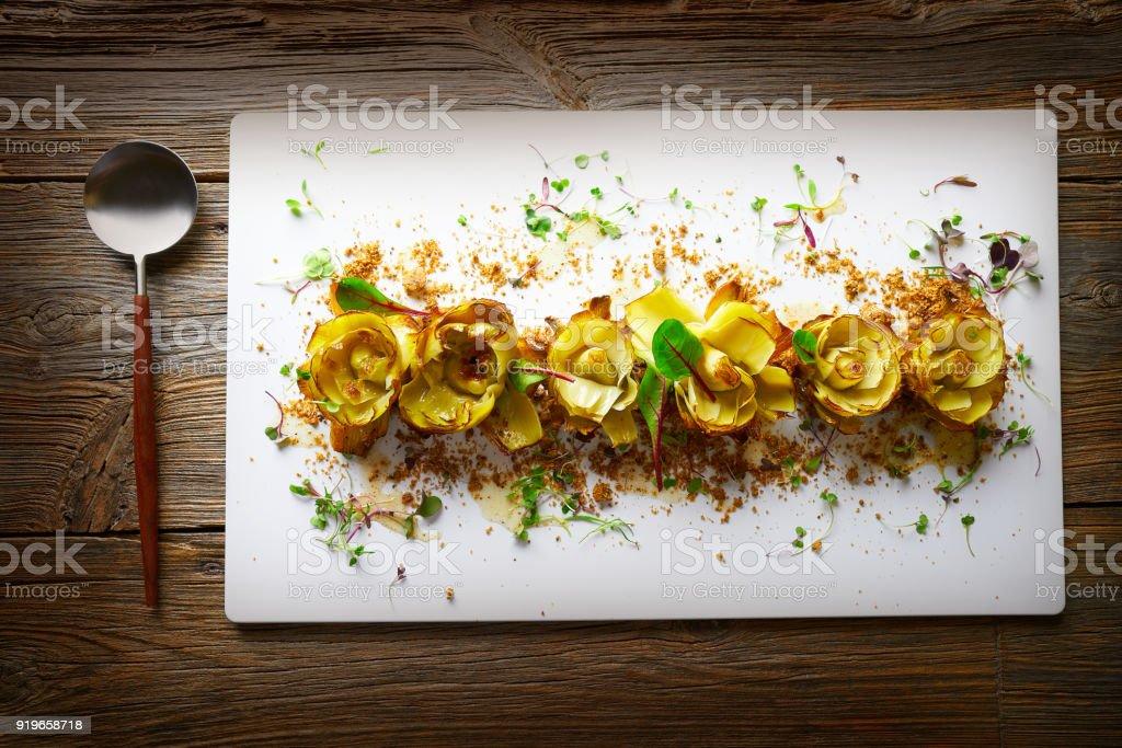Artichoke roses with truffle and vinaigrette stock photo