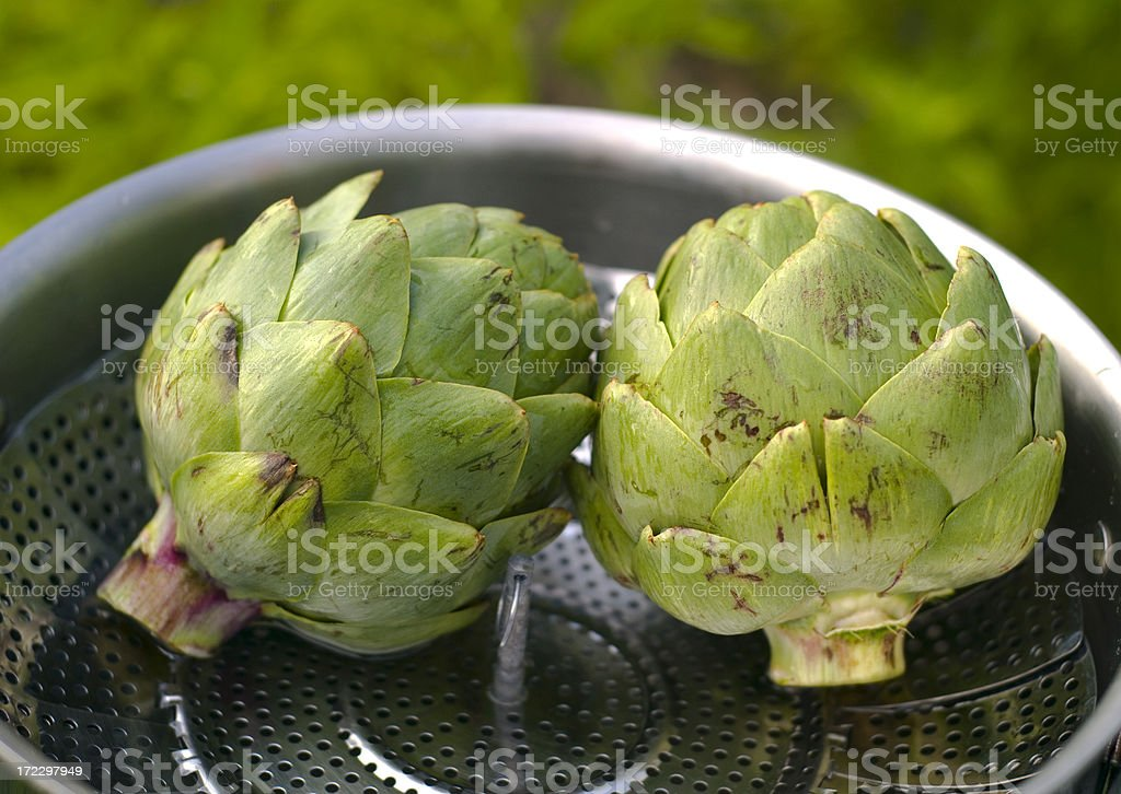 Artichokes Cooking in Steaming Pan, Fresh Food & Spring Green Vegetables royalty-free stock photo