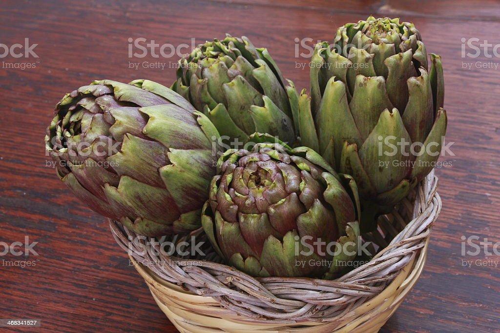Artichokes on table stock photo