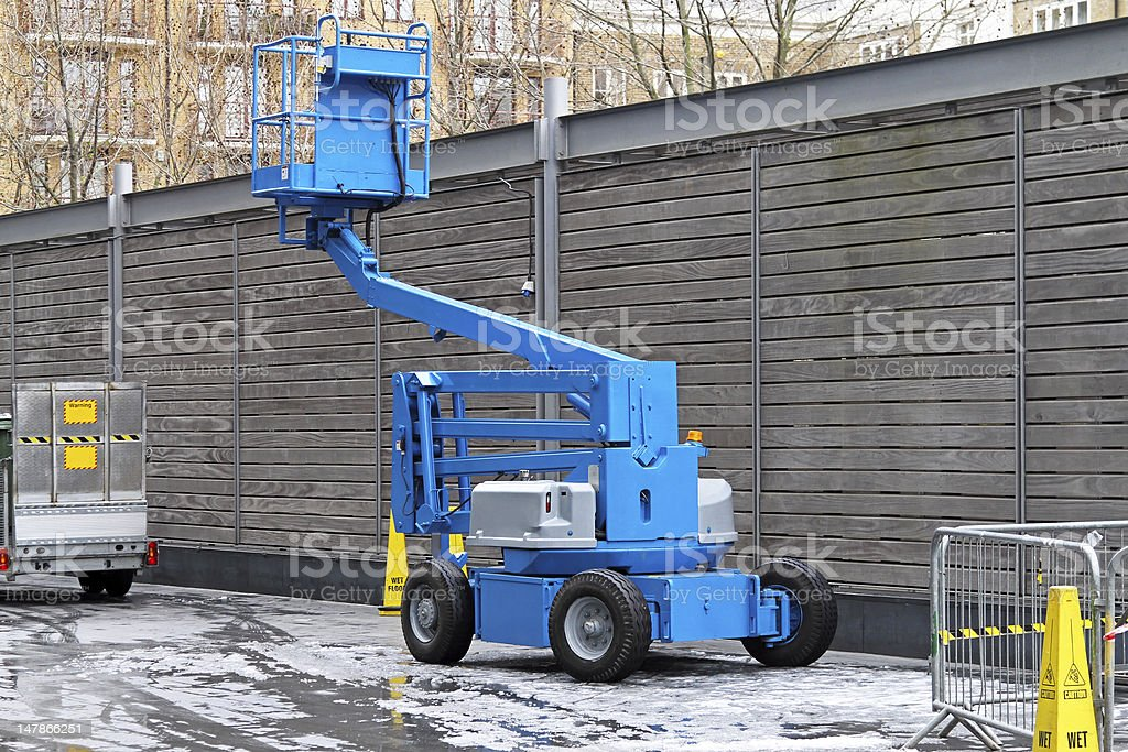 Articulated boom lift stock photo