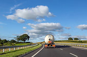 Carmarthen, UK: July 05, 2016: Following road haulage. Flammable materials being transported across countryside.