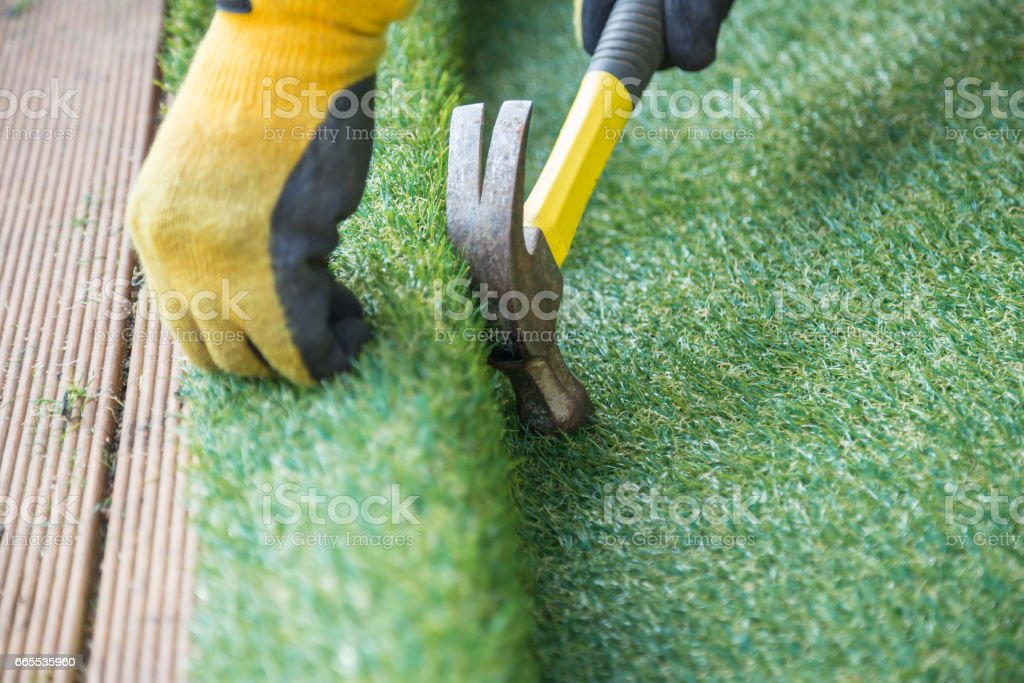 Artifcial grass, turf installation stock photo