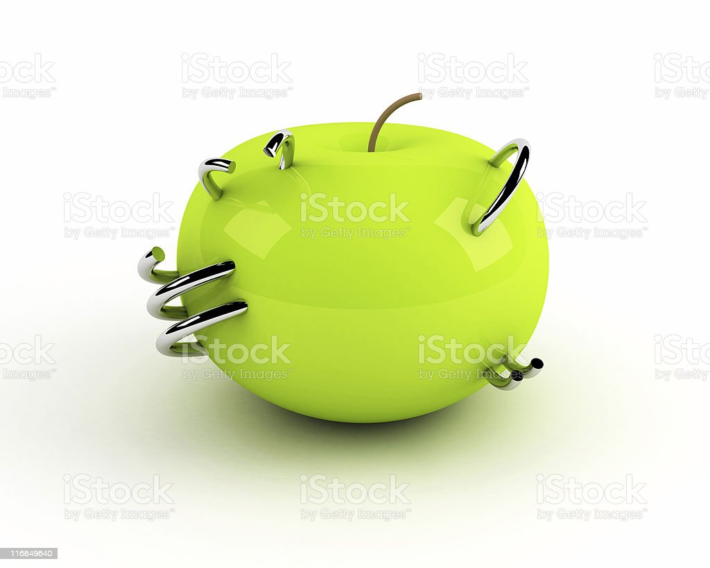 artificial apple with steel rings royalty-free stock photo