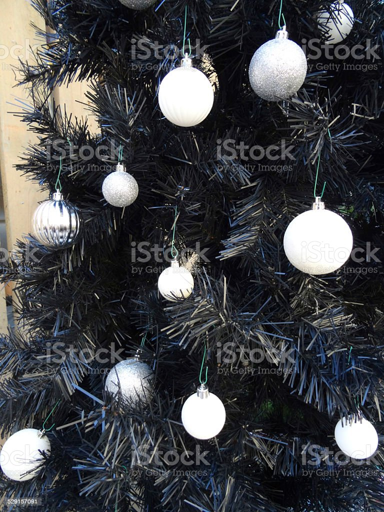 Artificial Black Christmas Tree With White Baubles Silverdecorations Christmas Tree Stock Photo Download Image Now Istock