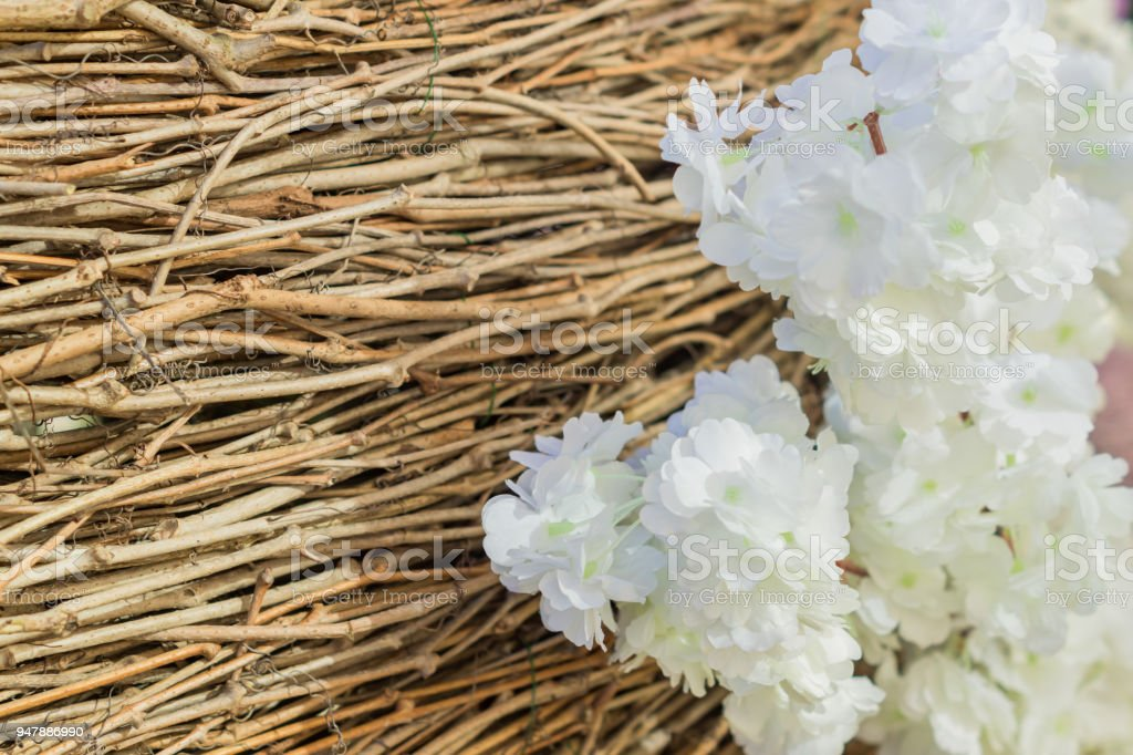 artificial branches of blooming apple tree on brown brushwood background stock photo