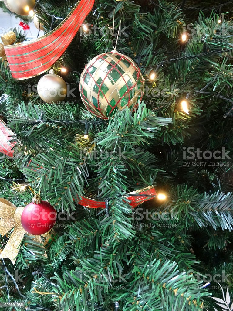 Artificial Christmas Tree Decorations Baubles Red And Silver Ribbons Fairylights Stock Download Image Now